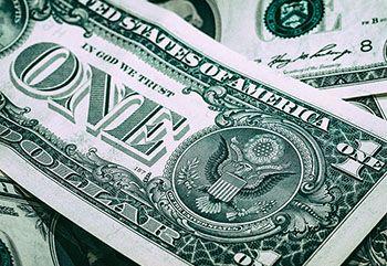 Płynność finansowa (księgowa) – obrazek ozdobny, przedstawiający dolary (gotówkę)